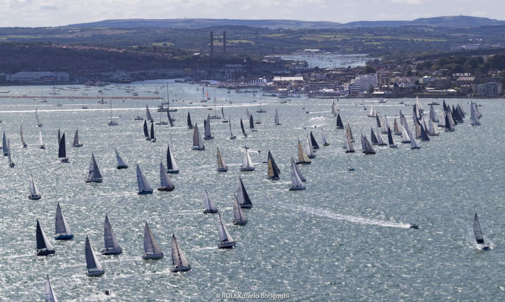 The 47th Rolex Fastnet Race gets underway from the Royal Yacht Squadron line, Cowes, Isle of Wight UK © Rolex/Carlo Borlenghi