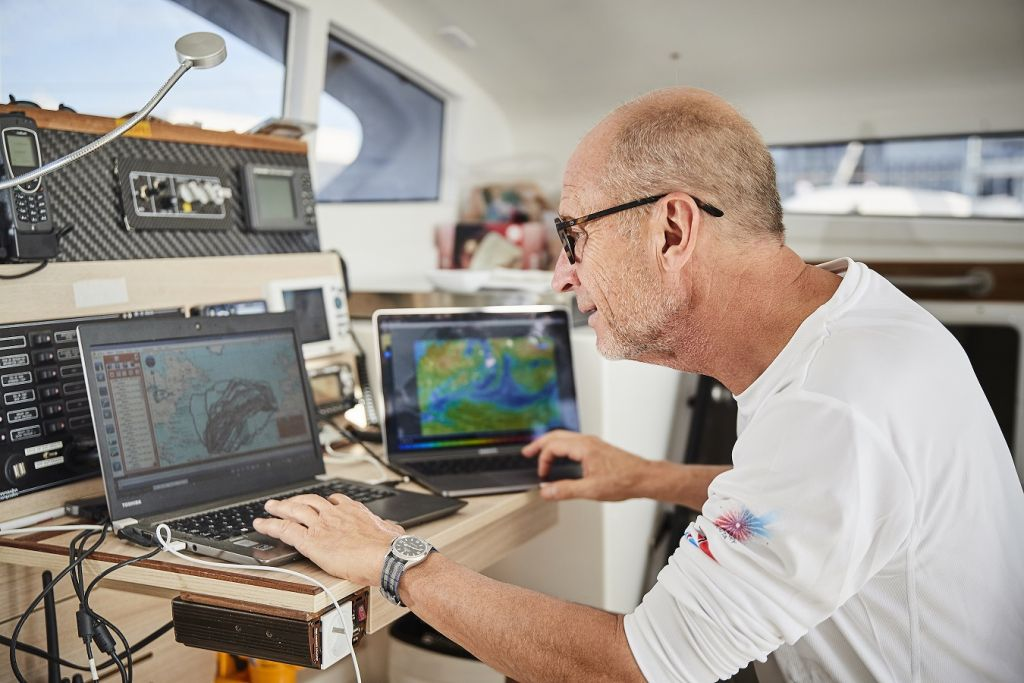 Gerald Bibot analysing the weather scenario for the 2017 RORC Transatlantic Race. He is competing for the second time in his catamaran Zed 6 © RORC/James Mitchell