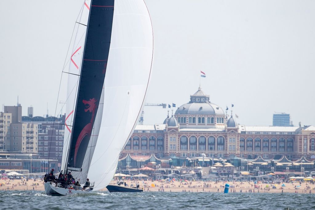 Beau Geste heads at their gold medal finish with beachgoers enjoying another fabulous day © Sander van der Borch