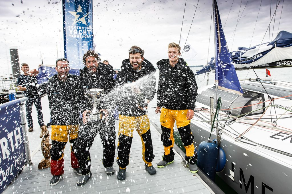 Champagne celebration for Imerys Clean Energy's Phil Sharp, Julien Pulvé, Pablo Santurdé and Sam Matson  after completing the race in record time for a 40ft yacht © Paul Wyeth/RORC