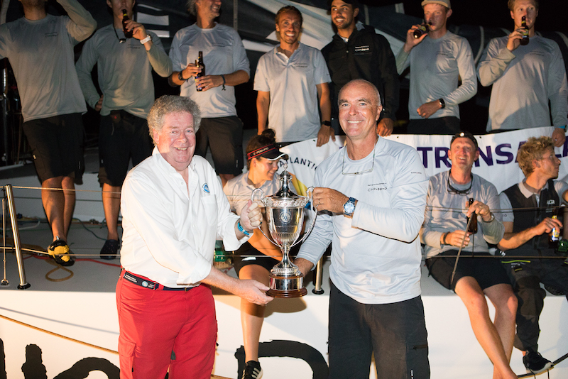 Andrew McIrvine, Secretary General of the IMA, presents the IMA Trophy to Childhood 1 skipper Bouwe Bekking - Photo © RORC / Arthur Daniel